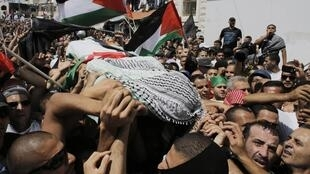 Les funérailles du jeune Palestinien assassiné, Mohamed Abou Khdeir, dans la banlieue de Jérusalem, le 4 juillet 2014.