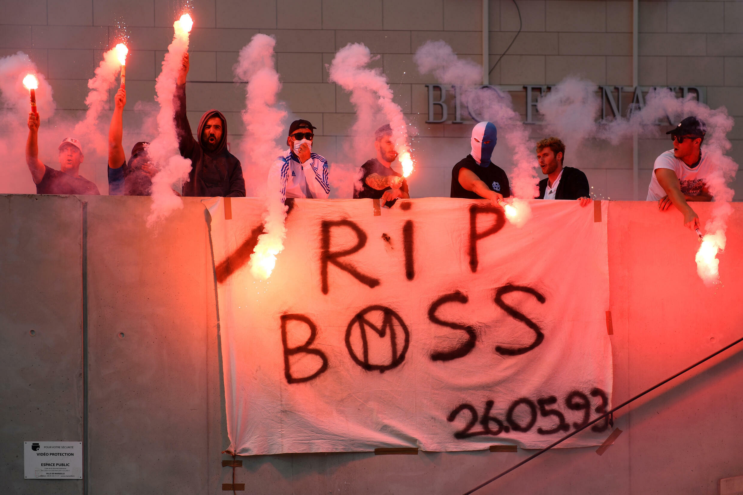 Marseille's supporters wave flares as they pay homage to late Bernard Tapie