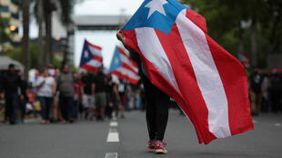 Manifestación contra las medidas de austeridad del gobierno, en San Juan, Puerto Rico, este 1 de mayo de 2017.