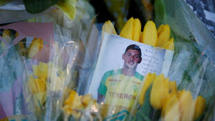 Flowers and a photo of Emiliano Sala at a memorial shrine outside the Nantes statdium