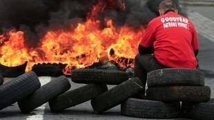 Tyres burn outside the Amiens North Goodyear factory