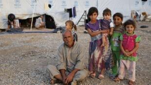 Беженцы из Мосула в  палаточном лагере в Эрбиле, иракский Курдистан, 19 сентября 2014 г.