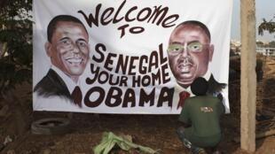 Hoton Shugaban Amurka Barack Obama da shugaban Senegal  Macky Sall da wani ya zana yana ma shugaban maraba a ziyarar da zai kawo a kasashen Afrika