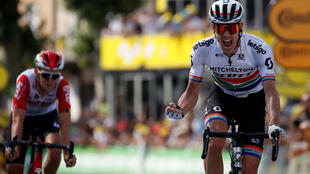 Daryl Impey of South Africa wins the 170.5-km stage 9 from Saint-Etienne to Brioude, ahead of Tiesj Benoot of Belgium, 14 July 2019.
