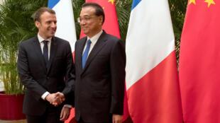 2018年1月9日,法国总统马克龙与中国国务院总理李克强在北京人大会堂会晤。