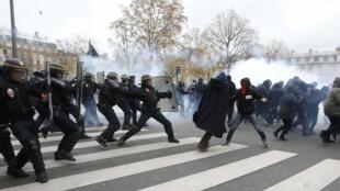 Demonstrators clash with CRS riot policemen near the Place de la Republique