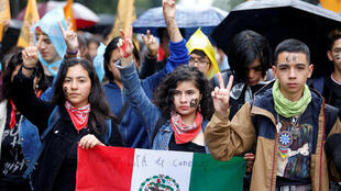 Students gesture during the 'March of Silence' to demand the end of violence against students of the National Autonomous University of Mexico (UNAM) in Mexico City, Mexico September 13, 2018.