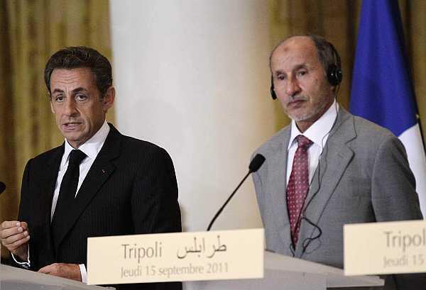 French President Nicolas Sarkozy with National Transitonal Council head Abdel Jalil in Tripoli in September