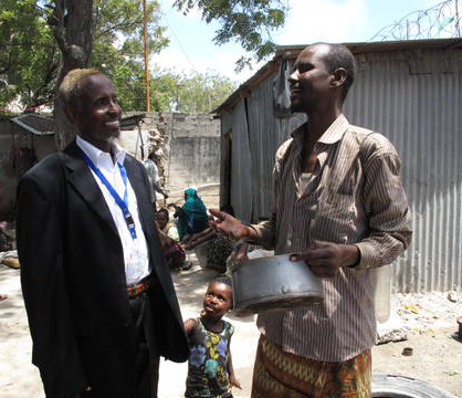 Dr. Awale chatting with one of his patients.