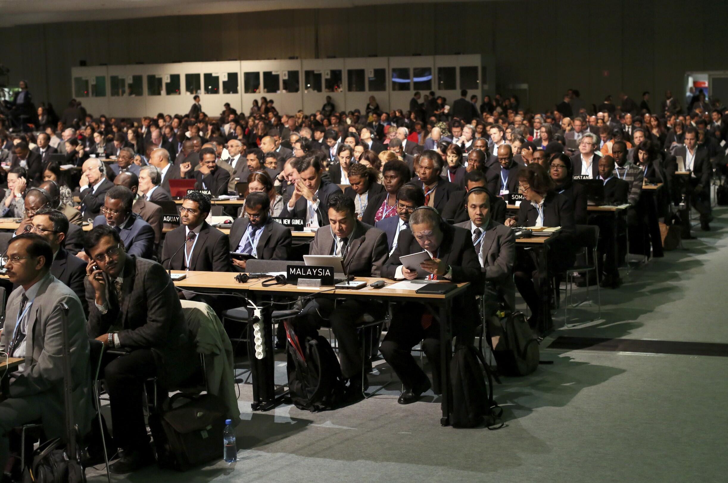 Delegados participam de cerimônia de abertura da COP 19.