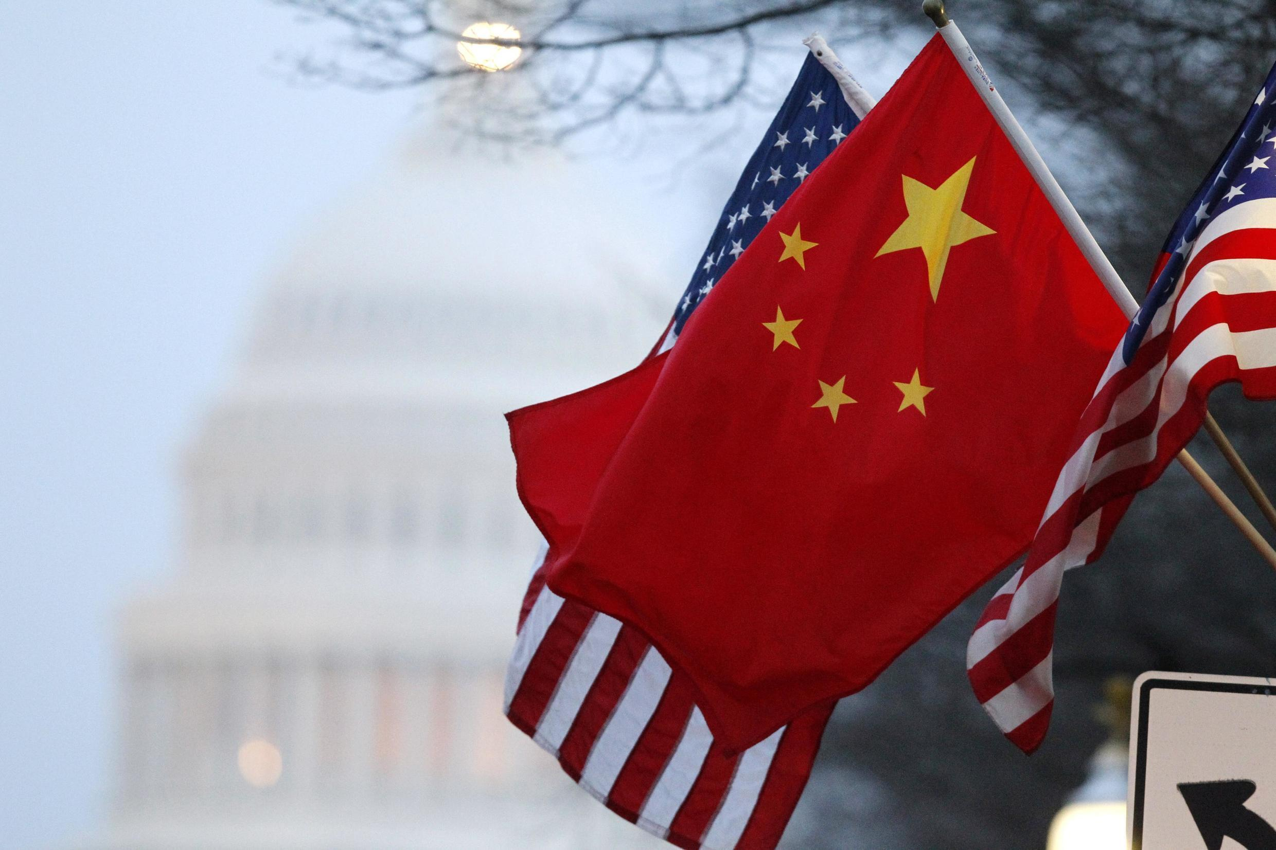 The People's Republic of China flag and the U.S. Stars and Stripes fly along Pennsylvania Avenue near the U.S. Capitol in Washington during Chinese President Hu Jintao's state visit in this January 18, 2011 file photo. Today, relations are less cordial and a first summit between US President Joe Biden and his Chinese counterpart Xi Jinping is still to happen.