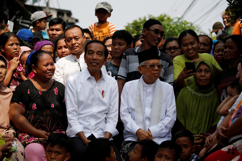 «Nous serons les dirigeants et les protecteurs de tous les Indonésiens», a promis Joko Widodo au côté de son colistier Ma'ruf Amin, le 21 mai 2019.