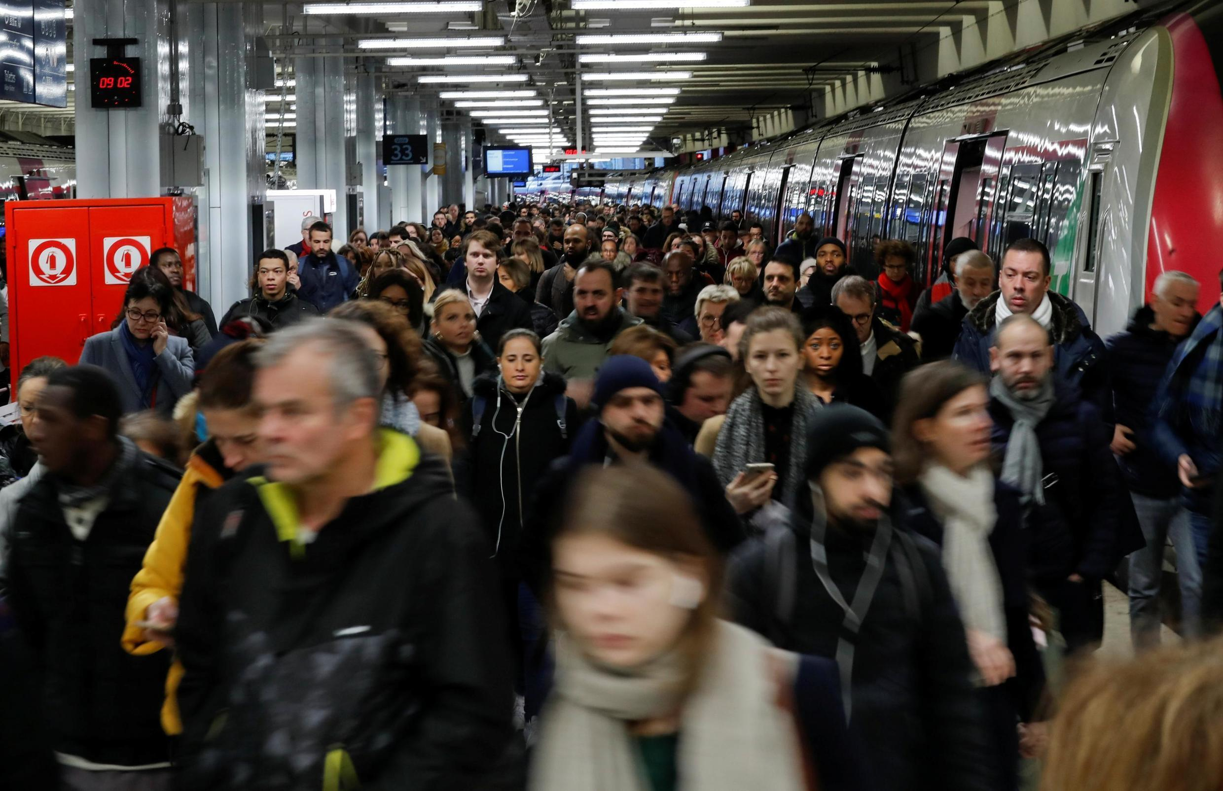 Commuters walk on a platform at Gare du Nord railway station after 42 days of strike by all unions of the Paris transport network (RATP) and French SNCF workers, Paris, January 15, 2020.