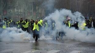 Yellow Vest (Gilets jaunes) protestors demonstrate on the Champs Elysees on Saturday