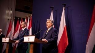 2020-11-26T164842Z_715700672_RC24BK9NG0S5_RTRMADP_3_EU-BUDGET-HUNGARY-POLAND