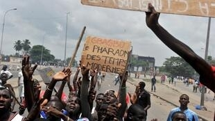 Pro-Ouattara demonstrators express their anger at the new wave of violence in Abidjan on Thursday.