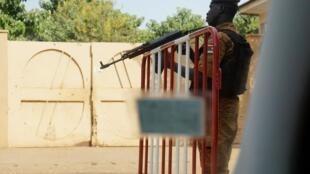 The 12 men who were arrested in northeastern Burkina Faso were taken to gendarme baracks in Tanwalbougou. File photo of  gendarme patroling at a school in Ouagadougou, the capital.