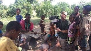 Jamie Welham filming dancing children from the Bara tribe in a village Madagascar's Red Zone