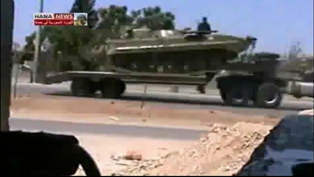 Military vehicles are transported on the highway from Talbiseh in Homs towards Hama in this still image taken from video posted on a social media website on 4 August 2011.