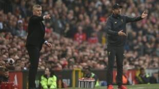 Les entraîneurs de Manchester United Ole Gunnar Solskjaer et de Liverpool Jürgen Klopp, le 24 février 2019 à Old Trafford