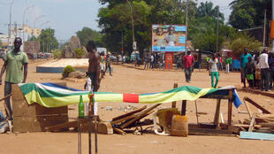 Civilians put up a barricade in Bangui during a protest against UN peacekeeping force MINUSCA on October 24, 2016