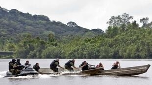 Gendarmes on a riverborne mission to track down illegal gold prospectors in French Guiana