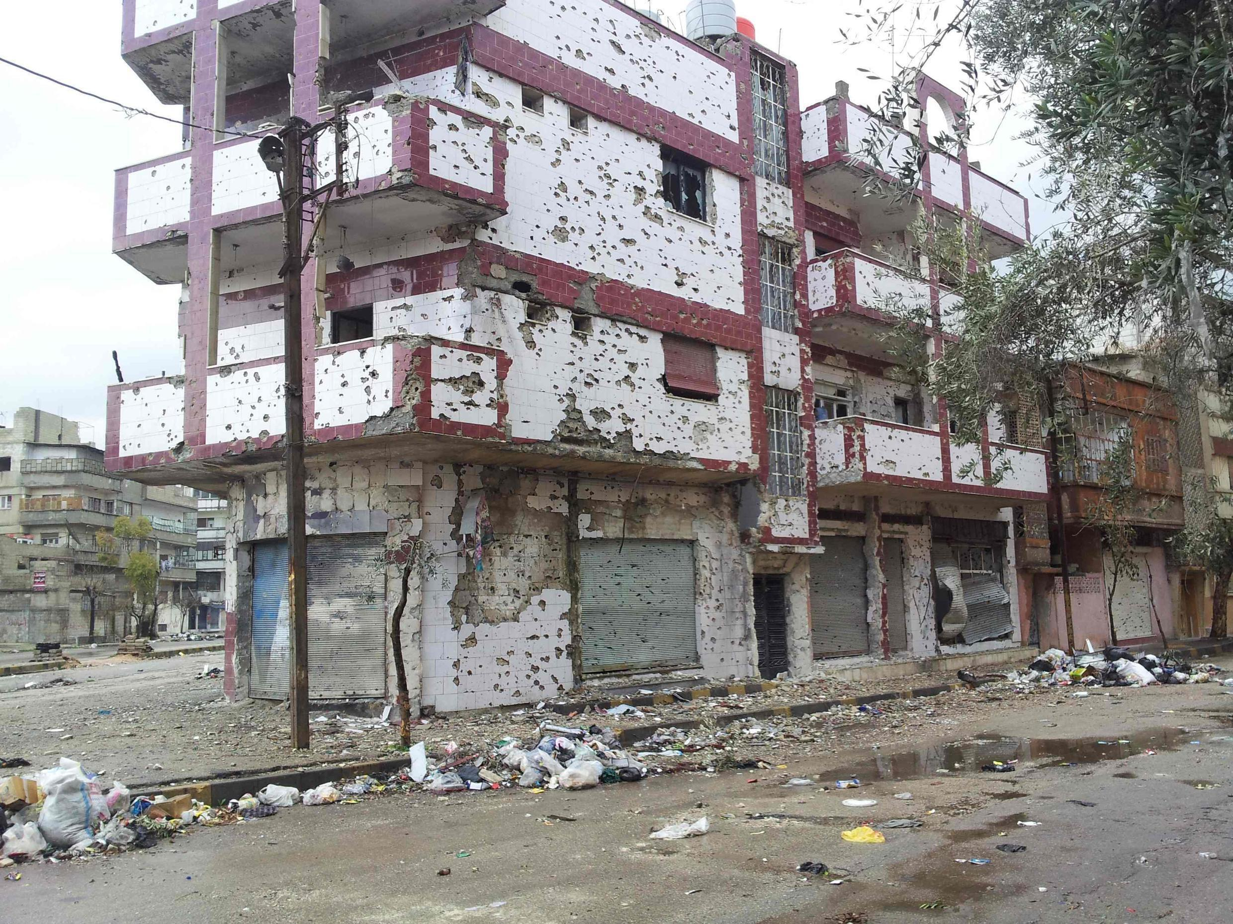 Damaged buildings in the Bab Sabaa district of Homs, where the journalists were hit