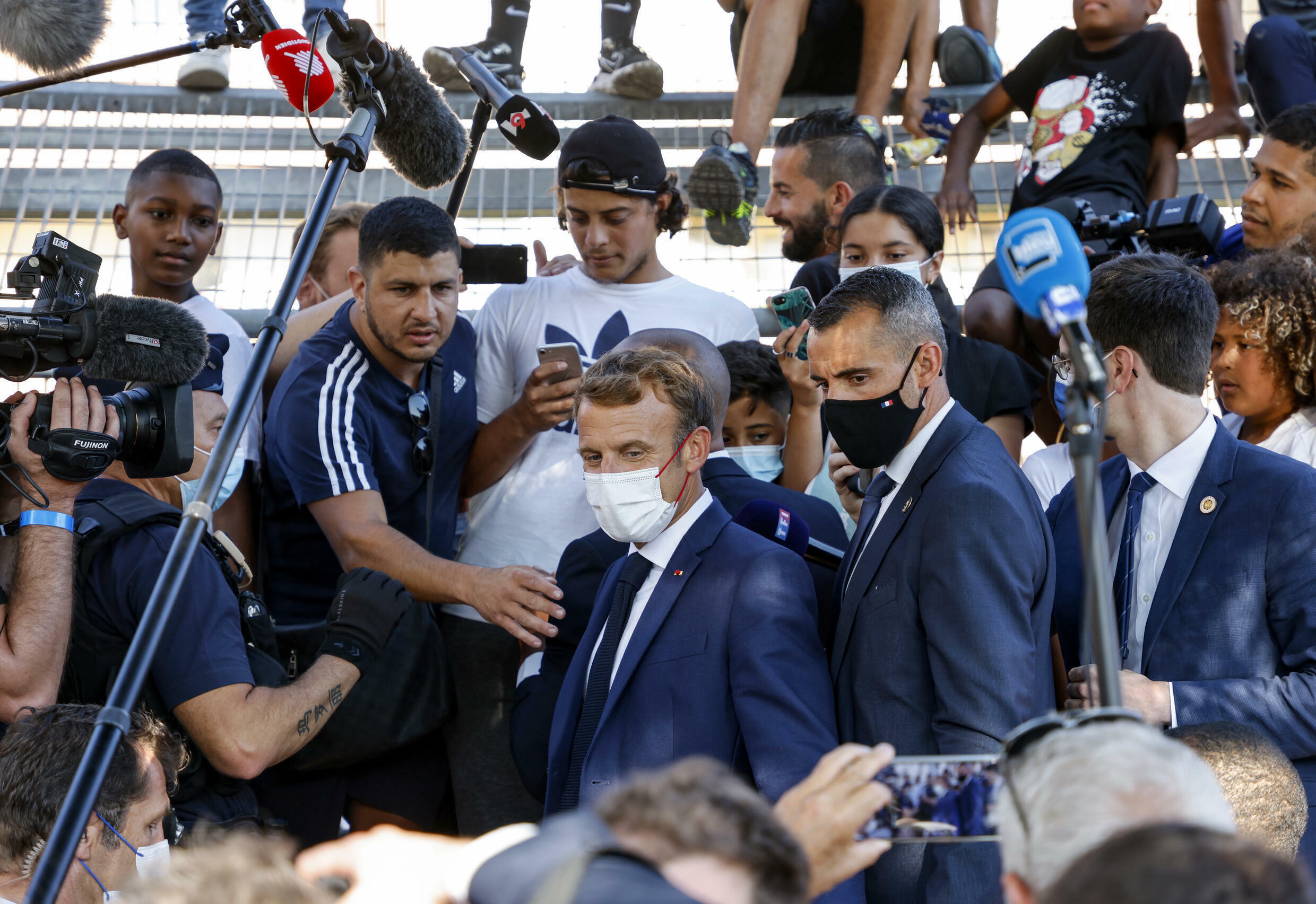 Macron met residents of the rundown district of Bassens on the first day of a three-day visit to Marseille