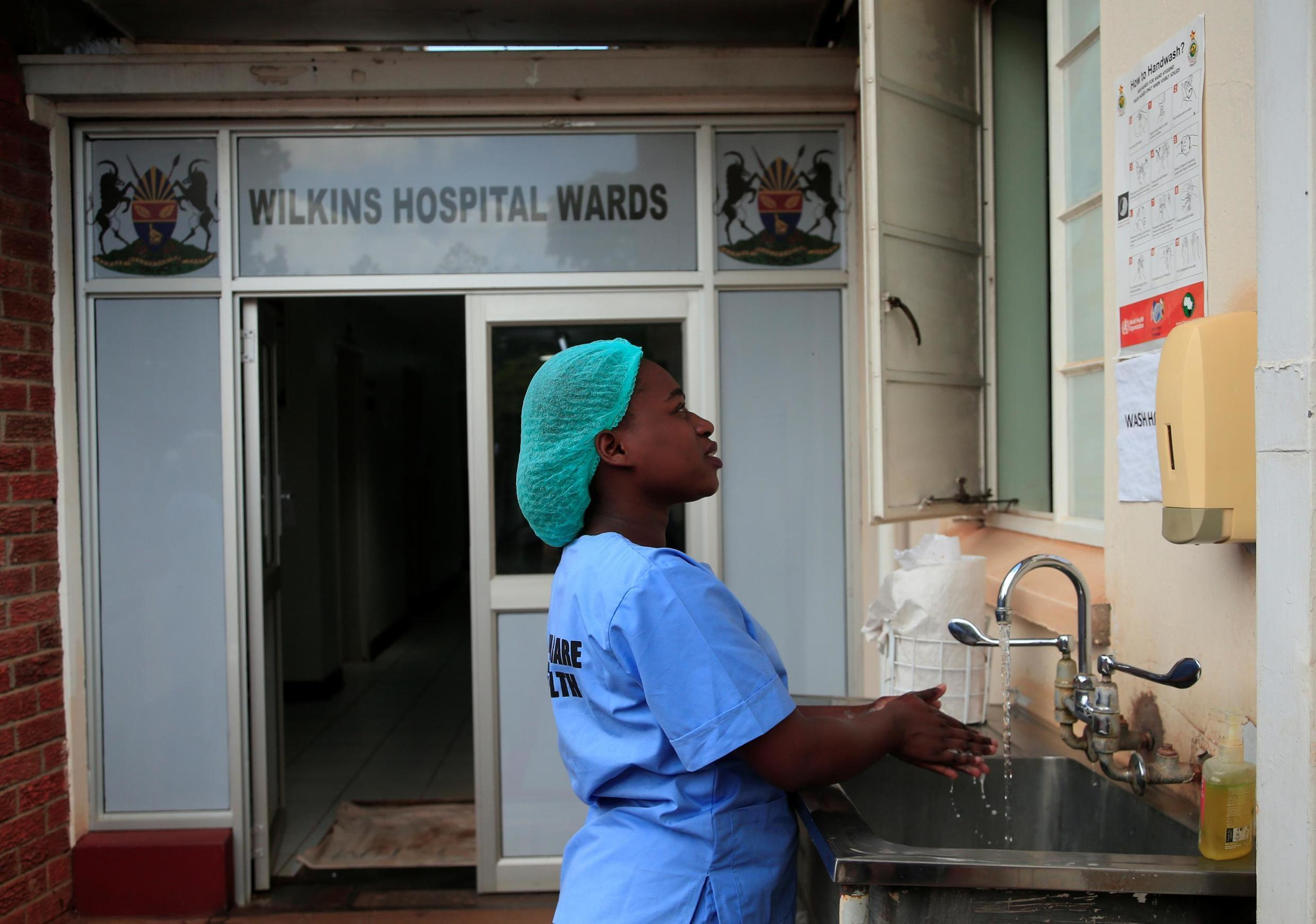 File photo of a nurse washing her hands at a hospital in Harare, Zimbabwe, March 2020.