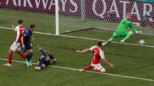 Joel Pohjanpalo, on the ground, won the game for Finland after Denmark's Christian Eriksen collapsed and had to be revived