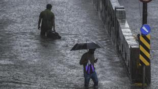 Seasonal monsoon rains hit Mumbai on Wednesday, bringing widespread flooding and traffic chaos