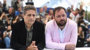 Le réalisateur brésilien Kleber Mendonca Filho (à gauche) et le réalisateur brésilien Juliano Dornelles posent lors d'un photocall pour le film «Bacurau» lors de la 72e édition du Festival de Cannes, le 16 mai 2019.