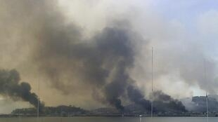 Smoke rises from South Korean Yeonpyeong Island after being hit by dozens of shells