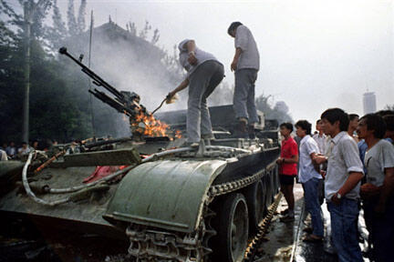 A burning tank after a confrontation with demonstrators in Beijing, June 4, 1989