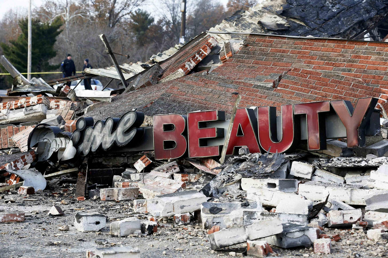 Разрушенный во время беспорядков магазин в Фергюсоне 25/11/2014