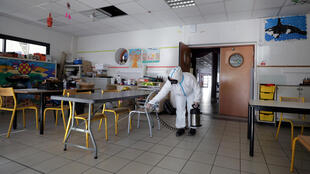 A classroom in Cannes, southern France, is disinfected. President Emmanuel Macron said Monday that schools would reopen gradually as of 11 May, with specific heath measures in place to protect teachers and students from the coronavirus.