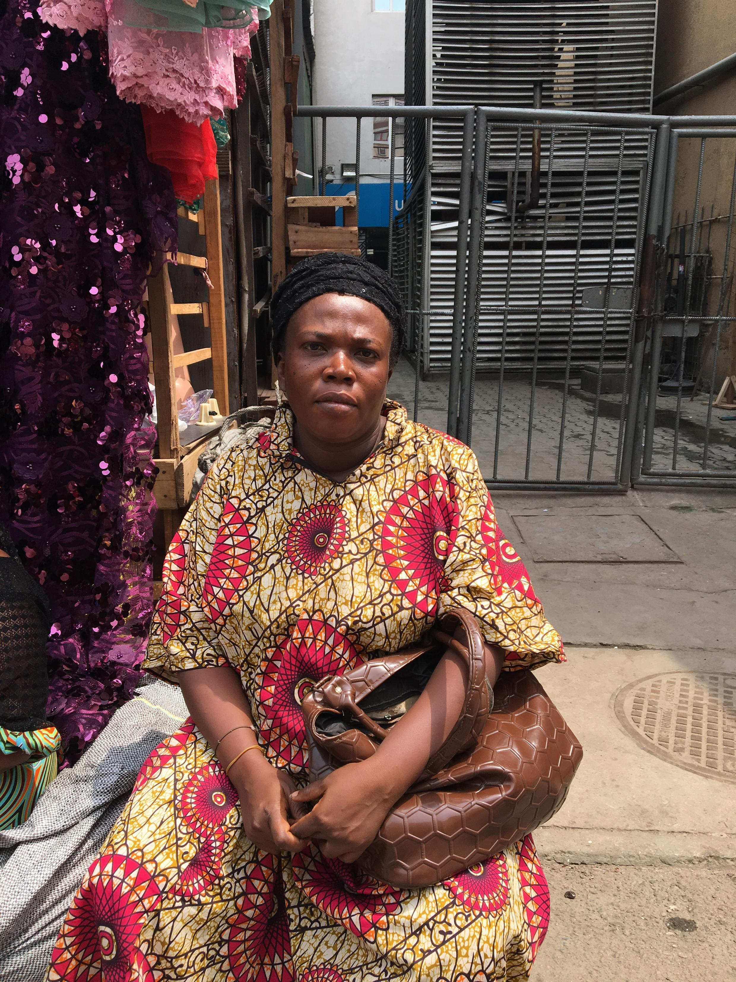 Ebere Ugonnia owns a fabric store in the market, Lagos Island February 16th, 2019