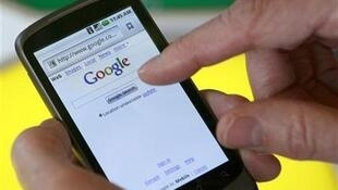 A model demonstrates a Nexus One smartphone, the first mobile phone Google will sell directly to consumers based on its Android platform, after a news conference at Google headquarters in Mountain View, California January 5, 2010.