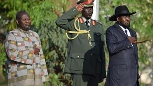 President Kiir and Vice President Machar stand during the national anthem after swearing-in ceremony, 26 April 2016.
