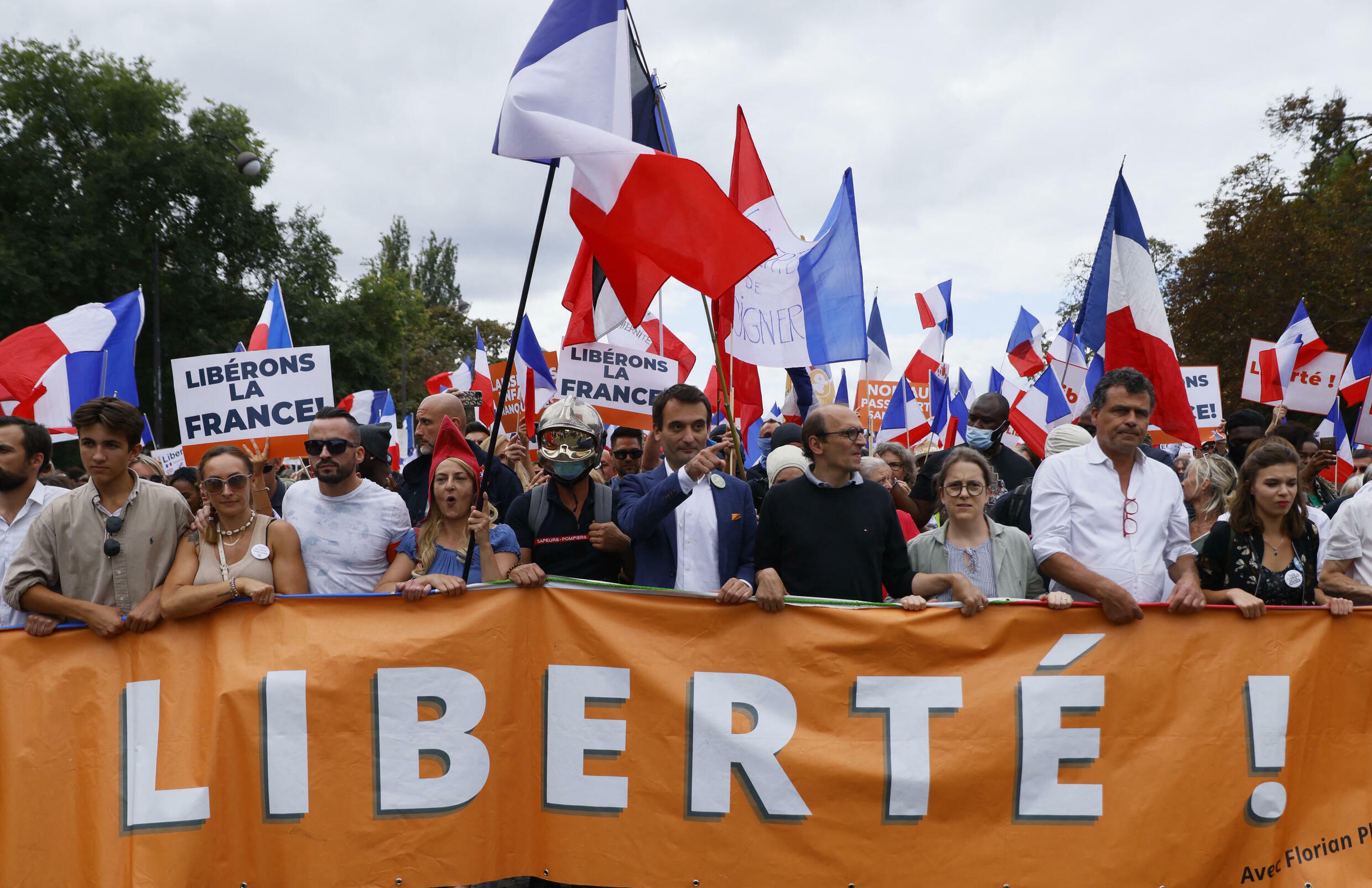 Florian Philippot (C) leads the Patriots rally in Paris, 11 September
