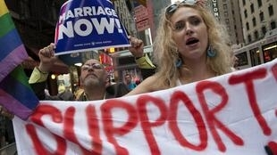 Supporters of gay marriage demonstrate outside the Sheraton Hotel, where Barack Obama is staying, on Thursday