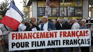 Demonstrators protest against Hors La Loi during a screening at a cinema in Marseille