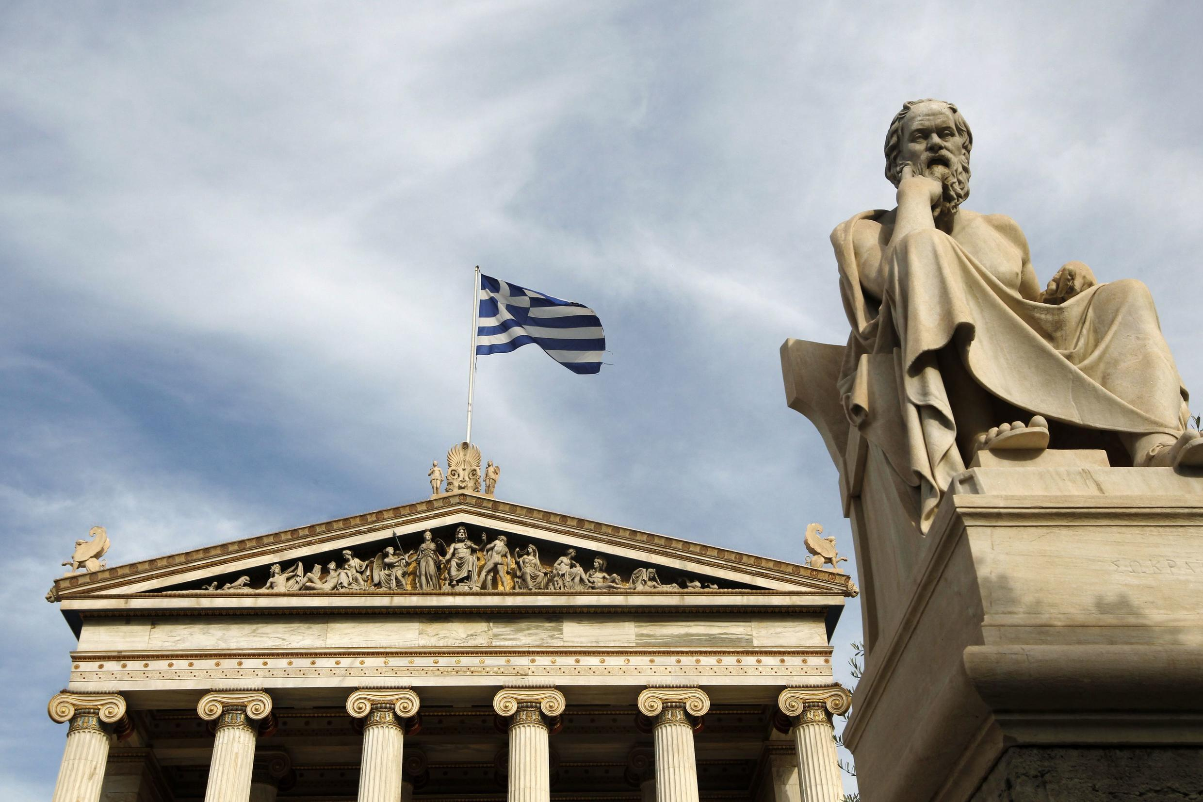 A statue of Greek philosopher Socrates outside the Athens Academy.