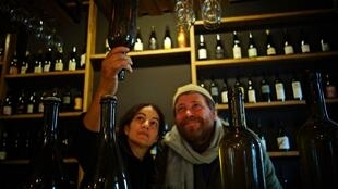 John Wurdeman and Nuria Renom examine a bottle of natural Georgian wine at the Pheasant's Tears winery.