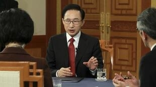 South Korea President Lee Myung-Bak urges North to improve ties