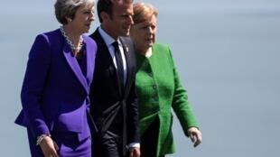 A primeira-ministra britânica, Theresa May (esquerda), o presidente francês, Emmanuel Macron, e a chanceler alemã, Angela Merkel, em foto de 8 de junho de 2018, no Canadá.