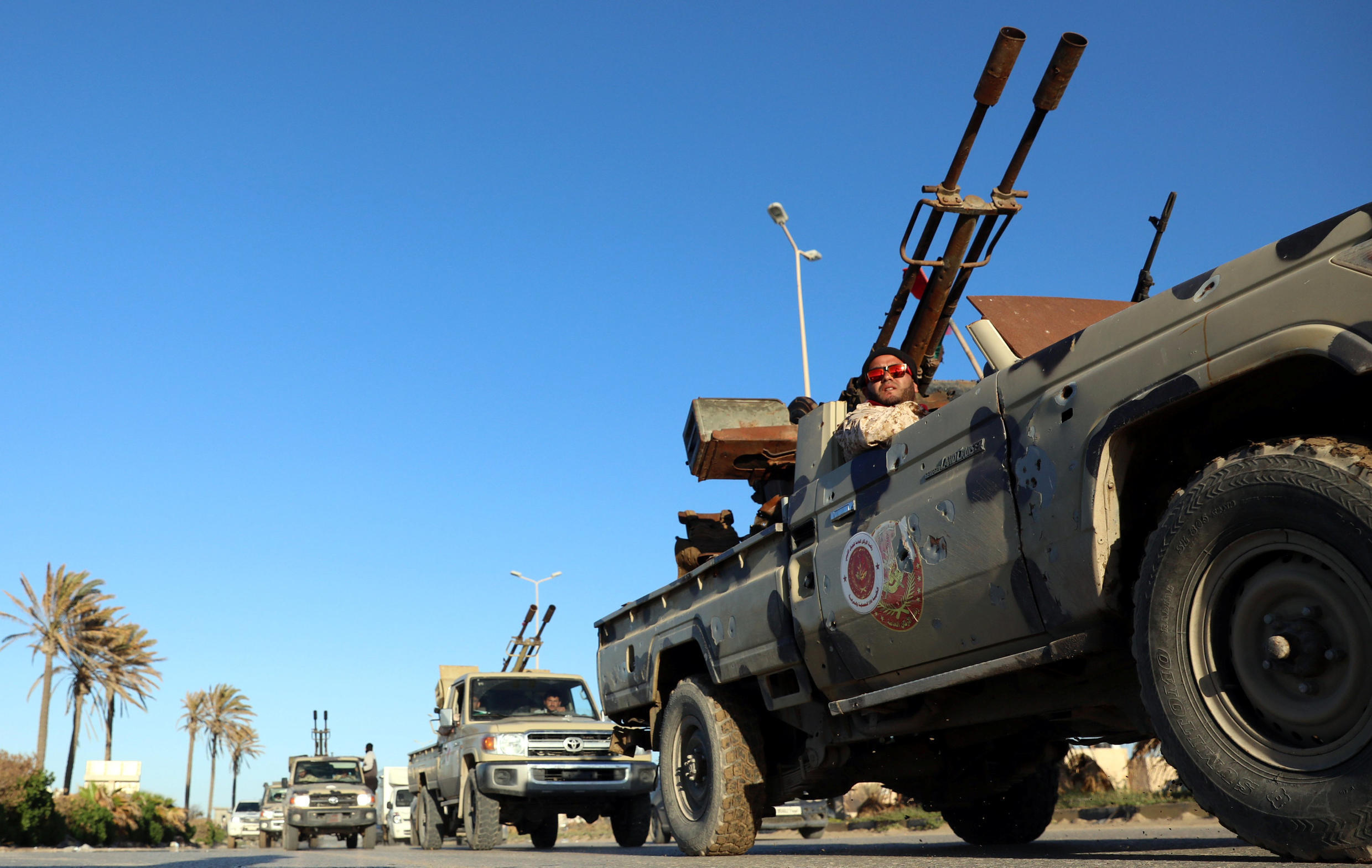Military vehicles sent in from Misrata are seen in the Tajura neighbourhood, east of Tripoli, on 6 April, 2019.