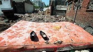 北京居民的住房被强行拆迁。