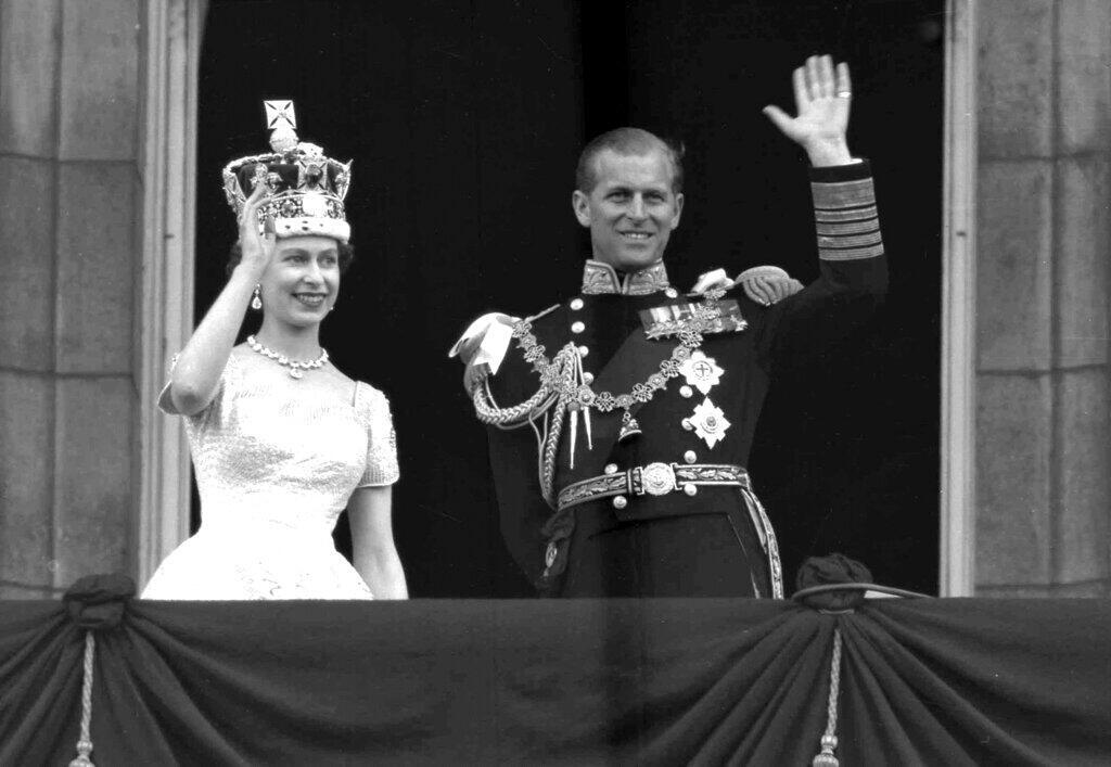 In this June 2, 1953 file photo, Britain's Queen Elizabeth II and her husband, the Duke of Edinburgh, wave from the balcony of Buckingham Palace, London, following the Queen's coronation at Westminster Abbey. Buckingham Palace says Prince Philip, husband of Queen Elizabeth II, has died aged 99.