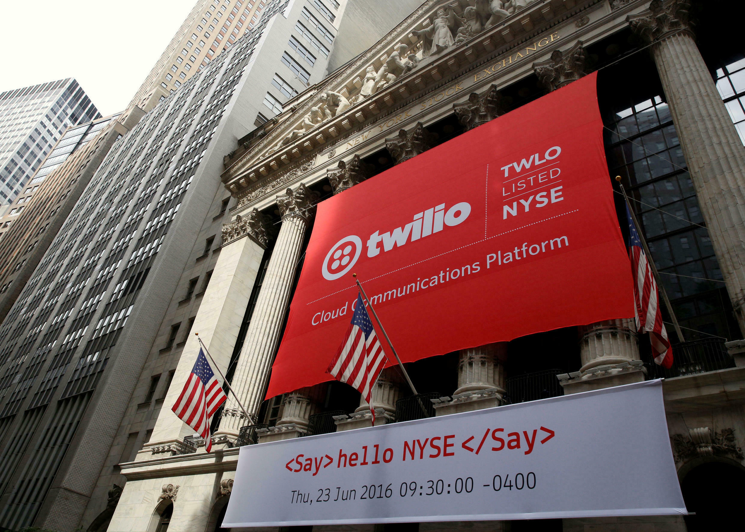 A banner for communications software provider Twilio Inc., hangs on the facade of the New York Stock Exchange (NYSE) to celebrate the company's IPO in New York City, U.S
